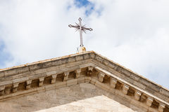 Ancient cross on medieval cathedral Stock Photography