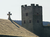 An ancient cross on the roof and fortress tower Royalty Free Stock Photos