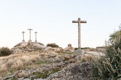 Ancient crosses of stone on hill and with fund at dusk Royalty Free Stock Image