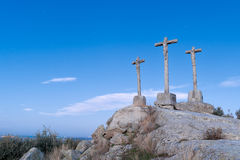 Ancient crosses of stone on hill and with fund at dusk Royalty Free Stock Photography