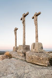 Ancient crosses of stone on hill and with fund at dusk Royalty Free Stock Images