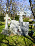 Ancient Crosses. Weathered Crosses mark these old graves Royalty Free Stock Images