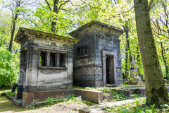 Ancient crypt with beautiful architecture. Old cemetery in St. Petersburg (Novodevichy cemetery). On the pictures one of the ancient crypts, which is perfectly royalty free stock photo
