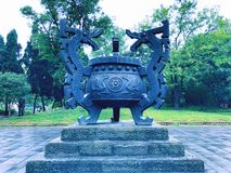 An ancient cultural relic urn with dragons sculpture. In Chengdu Wuhou Shrine, Sichuan province, China stock images
