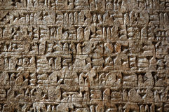 Ancient cuneiform writing. Ancient sumerian cuneiform writing engraved in a stone Stock Images