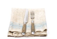 Ancient cutlery on linen Royalty Free Stock Photography