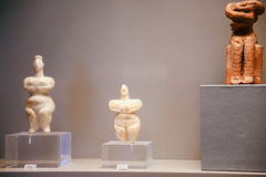 Ancient cycladic figurines in museum in Athens. ATHENS, GREECE - SEPTEMBER 12, 2007: ancient cycladic figurines in National Archaeological Museum. The museum is stock images