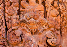 Ancient daemon carving on the wall Stock Photos