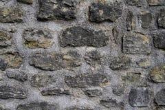 Ancient dark gray stone fortress wall Stock Photos