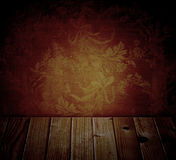 Ancient dark wall with floral pattern and wood planks Royalty Free Stock Images
