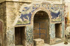 Ancient decorated grotto in the House of Neptune, Herculaneum, Italy. Ancient grotto or nymphaeum in the House of Neptune, Herculaneum, Italy decorated with Royalty Free Stock Image