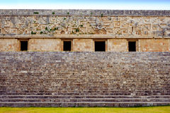 Ancient decorated wall and stairs in archeological site Uxmal Stock Images