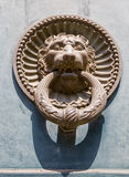 Ancient decorative door knocker. Royalty Free Stock Photos