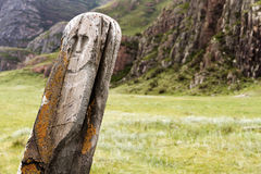 Ancient deer stone. At the Altai region, Russia. Deer stones (also known as reindeer stones) are ancient megaliths carved with symbols that can be found in Royalty Free Stock Photo