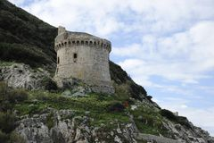 Ancient  defense tower Torre Paola on a hill near the Mediterranean Sea in the Circeo National Park. Coast of Lungomare di. Ancient defense tower Torre Paola on stock photos