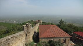 Ancient defensive fortress with stone towers located around city of Signagi. Long wall fortress. High quality stock footage shot with Sony 6500. Ancient stock video footage