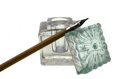 Ancient desk set. From an inkwell and  handles on a white background Stock Photos