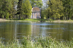 Ancient destroyed arbor in autumn park- The Eagle pavilion. Russia. Saint-Petersburg. Gatchina. Stock Photos