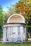 The ancient destroyed arbor in autumn park in a sunny day. Russia. Royalty Free Stock Photos