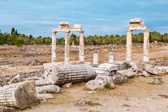 The ancient destroyed city of Hierapolis near Pamukkale, Denizli, Turkey in the summer. On a background the sky in overcast. Horiz. The ancient destroyed city of Royalty Free Stock Photos