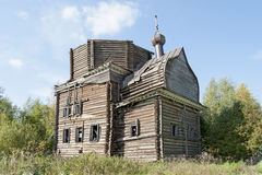 Ancient destroyed wooden church in northern russian village Royalty Free Stock Photos