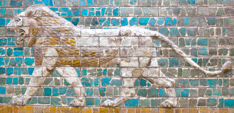 Ancient detail of the Babylonian Ishtar Tor. Ancient glazed brick panel with roaring Lion - details of the Babylonian Ischtar Tor, or Ishtar Gate stock image
