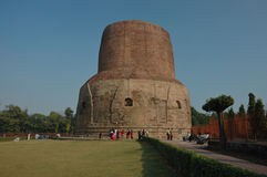 Ancient Dhamekh Stupa in Sarnath,India. Sarnath is the deer park where Gautama Buddha first taught the Dharma, and where the Buddhist Sangha came into existence stock photography