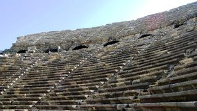 Ancient dilapidated amphitheater with stone seats royalty free stock photography