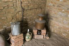 An ancient distillator. In front of an house in Europe royalty free stock image