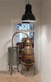 Ancient distiller for the production of perfume in Fragonard factory Royalty Free Stock Photo