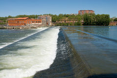 The ancient diverting dam on the Garonne river. stock images