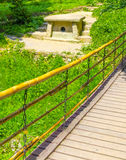 Ancient dolmen. Next to the suspension bridge Royalty Free Stock Photo