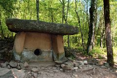 Ancient dolmens in the Caucasus. Ancient dolmen on the Pshada River. Artifacts, archeology, antiquity. Ancient culture, paganism royalty free stock images