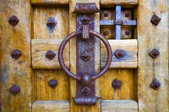 Ancient Door. Shor of a castle door with an iron knocker royalty free stock images