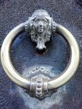Ancient door. With old bell door silver color royalty free stock photography