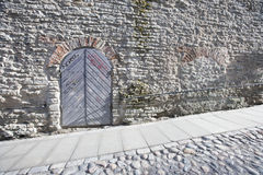Ancient door by cobblestone street, Tallinn, Estonia, Europe Stock Photos