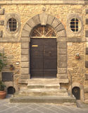 Ancient door in Cortona (Tuscany) Royalty Free Stock Photo