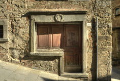 Ancient door in Cortona (Tuscany). Picture of a vintage wooden door Stock Photos