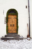 Ancient door decorated to Christmas Stock Images