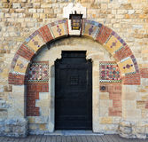 Ancient door with decorative tiles Royalty Free Stock Photos