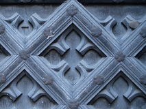 Ancient Door Design. A background with a closeup view of design on an ancient wooden door stock photos