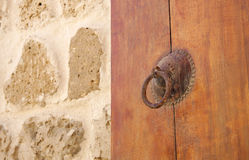 Ancient door with door knocker & the wall Royalty Free Stock Photo