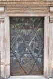 Ancient door of Franciscan Church in Salzburg, Austria stock images