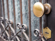 Ancient door gate with brass knob Royalty Free Stock Photography