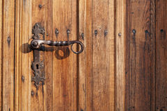 Ancient door handle on old door Royalty Free Stock Photo
