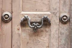 Ancient door handle in Venice Italy Stock Image