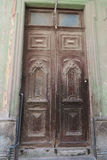 Ancient door in Havana, Cuba. An old faded cracked beautiful door in central Havana, Cuba, survived communistic regime, sample of colonial architecture Stock Photography