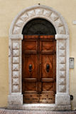 Ancient wood door of a historic building in Perugia (Tuscany, Italy) Royalty Free Stock Photography