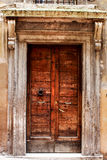 Ancient wood door of a historic building in Perugia (Tuscany, Italy). Ancient door of a historic building in Perugia (Tuscany, Italy). Entry with stone archway Royalty Free Stock Photo