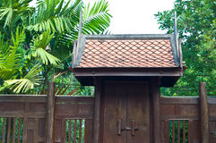 Ancient door of house. Ancient wooden door of thai house in Thailand Royalty Free Stock Photography